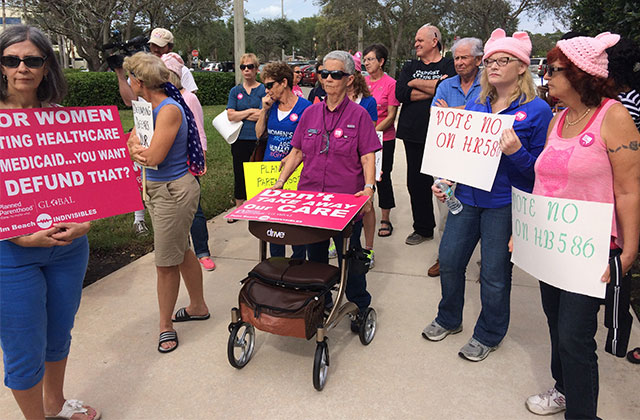 Dozens Support Planned Parenthood With Protest in Front of Brian Mast's Office
