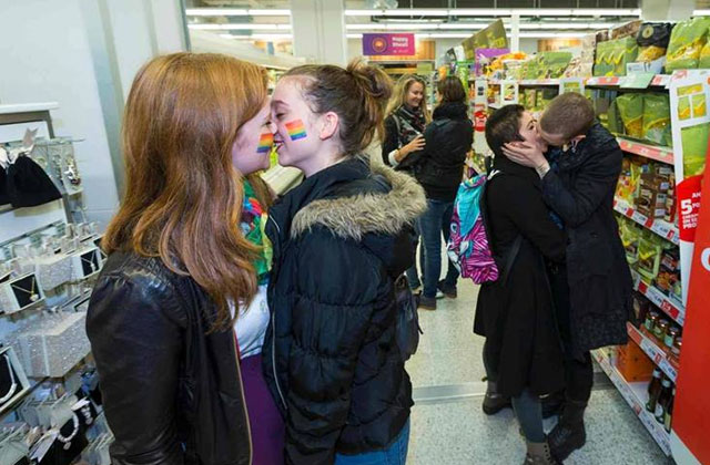 Sainsbury's kiss-in: Gay protestors descend on Hackney supermarket to kiss