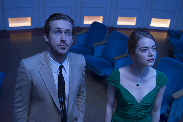 Emma Stone and Ryan Gosling stand on the set of LA LA LAND.