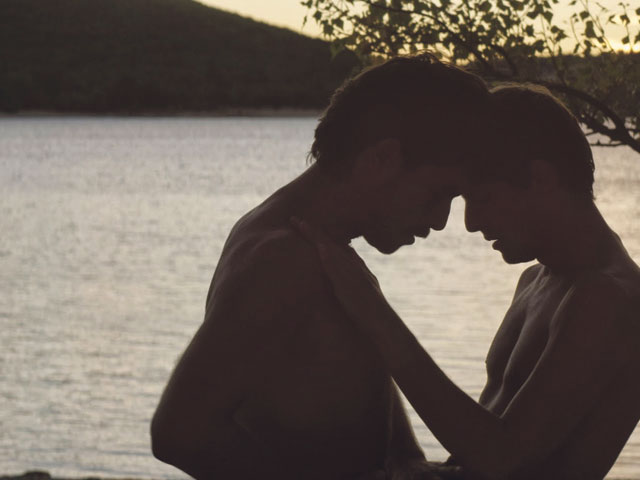 "Christophe Paou, left, and Perre Deladonchamps star in ""Strangers by the Lake,"" a dark sexual thriller set at a gay beach outside Paris. The film is currently screening at the Classic Gateway Theater in Fort Lauderdale. Courtesy: Strand Releasing"