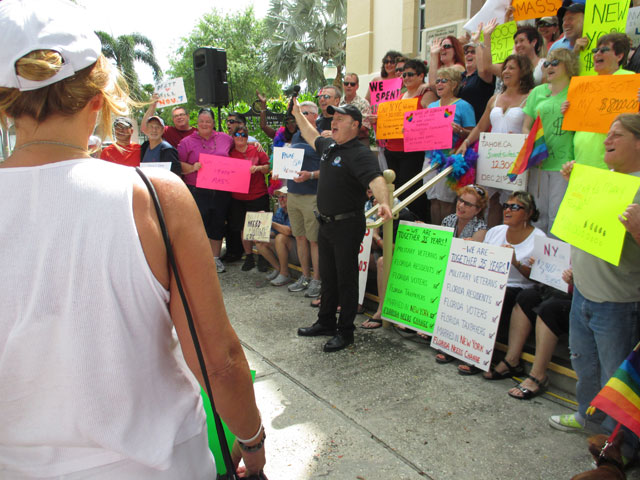 Andy Amoroso (center) leads the demonstration of lost revenues caused by Florida's denial of marriage equality. (Donald Cavanaugh)