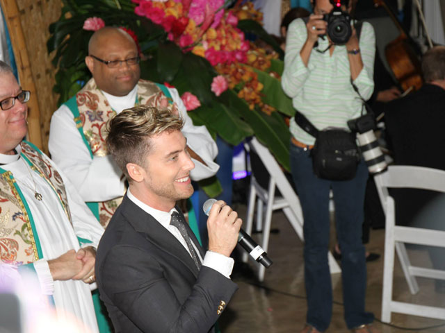 'Love is Love': Fort Lauderdale's Mass Wedding Goes On Despite Torrential Rain